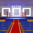 Boxing gym with blue ring and red corners - Stock Photo