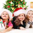 Children in Santa hats — Stock Photo