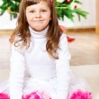 Girl in front of Christmas tree — Stock Photo