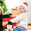 Kids with Christmas present — Stock Photo