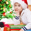 Boy in Christmas hat — Stock Photo