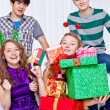 Girl with presents pile — Stock Photo