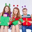 Happy teens with presents — Stock Photo