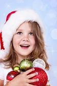 Preschool girl holding Christmas decoration — Stock Photo