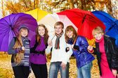 Friends with umbrellas — Stock Photo