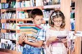 Books and e-reader — Stock Photo