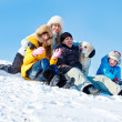 Winter family and a dog — Stock Photo