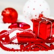 Sleigh carrying red Christmas present — Stock Photo #14856739