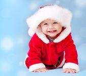 Sweet baby wearing Santa costume — Stock Photo