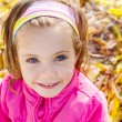 Girl over yellow autumn leaves — Stok Fotoğraf #15654441