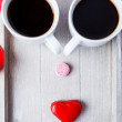 Stok fotoğraf: Two coffee cups and sweets
