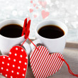 Valentine coffee cups with hearts — Stock Photo
