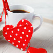 Stock Photo: Sweet little heart and coffee cup