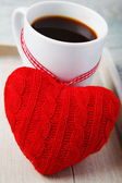Coffee cup and red heart — Stock Photo