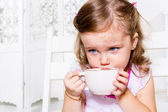 Girl with the tea cup — Stock Photo