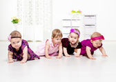 Toddler girls crawling — Stock Photo