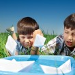 Kids playing with paper boats — Stock Photo