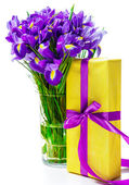 Present and flowers in vase — Stock Photo