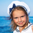 Girl in sailor clothing - Stock Photo