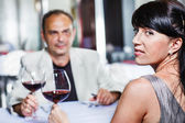 Woman and her husband in a restaurant — Stock Photo