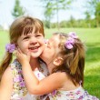 Girl kissing her sister — Stock Photo