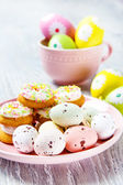 Tiny Easter eggs and cookies — Stock Photo