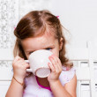 Preschool girl with a cup — Stock Photo #22583403
