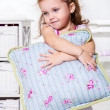 Toddler girl with pillow — Stock Photo