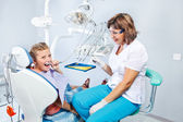 Kid playing with dental drill — Stock Photo