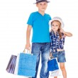 Boy and girl with customer paper bags — Stock Photo