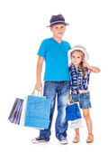 Boy and girl with customer paper bags — Foto de Stock