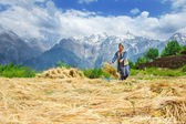 Woman drying harvest — Stock Photo