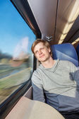 Man traveling by train — Stock Photo