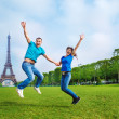 Jumping in front of the Eiffel Tower — Stock Photo