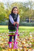 Autumn girl with umbrella — Stock Photo