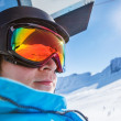 Skier riding a chairlift — Stockfoto