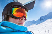 Skier riding a chairlift — Foto Stock