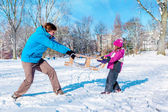 Dad daughter pulling sledges — Stock Photo