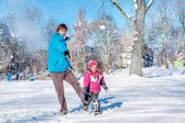 Father and daughter playing snowball — Stock Photo