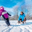 Happy father and kid with sledges — Stock Photo