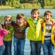 Kids in autumn clothing — Stock Photo