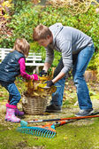 Picking up yellow leaves — Stock Photo