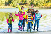 Kids in rubber boots — Stock Photo