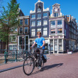 Man riding a bicycle in Amsterdam — Stock Photo