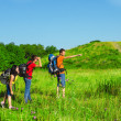 Backpackers observing the area — Stock Photo