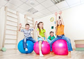 Cheerful kids with their hands up — Stock Photo