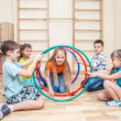 Kids with hula hoops — Stockfoto