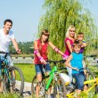Stock Photo: Parents and kids cycling