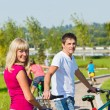 Parents enjoying cycling — Stock Photo