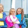 Stock Photo: Smiling friends with backpacks